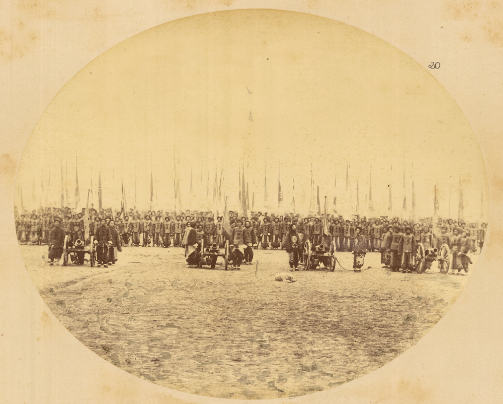 5713da809657b_Troops_Carrying_Flags_in_M