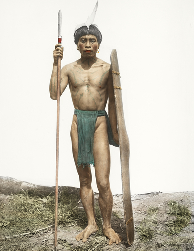An-Ifugao-warrior-poses-with-a-shield-an