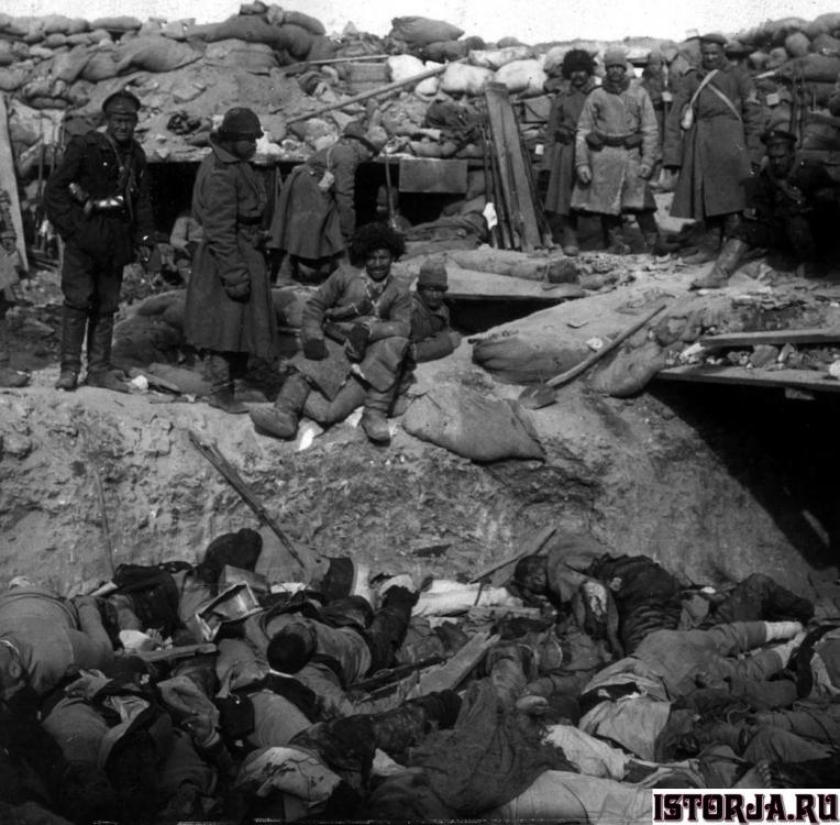 Russian_soldiers_stand_over_trench_of_de